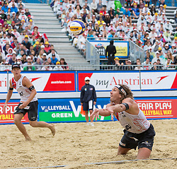 02.08.2015, Strandbad, Klagenfurt, AUT, A1 Beachvolleyball EM 2015, Halbfinale Herren, im Bild Aleksandrs Samoilovs 1 LAT / Janis Smedins 2 LAT // during Semifinal Final Men, of the A1 Beachvolleyball European Championship at the Strandbad Klagenfurt, Austria on 2015/08/02. EXPA Pictures © 2015, EXPA Pictures © 2015, PhotoCredit: EXPA/ Mag. Gert Steinthaler