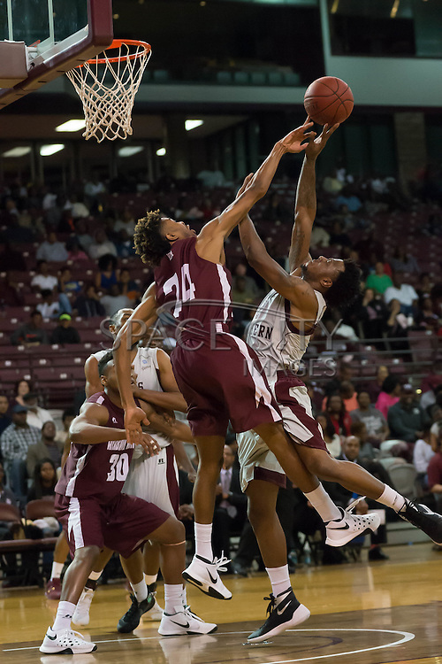 Arthur Wade of Alabama A&M blocks Chris Thomas of TSU. TSU defeats Alabama A&M 77-54 at the HP&E Arena in Houston, Texas. Photo By: Jerome Hicks/ Space City Images