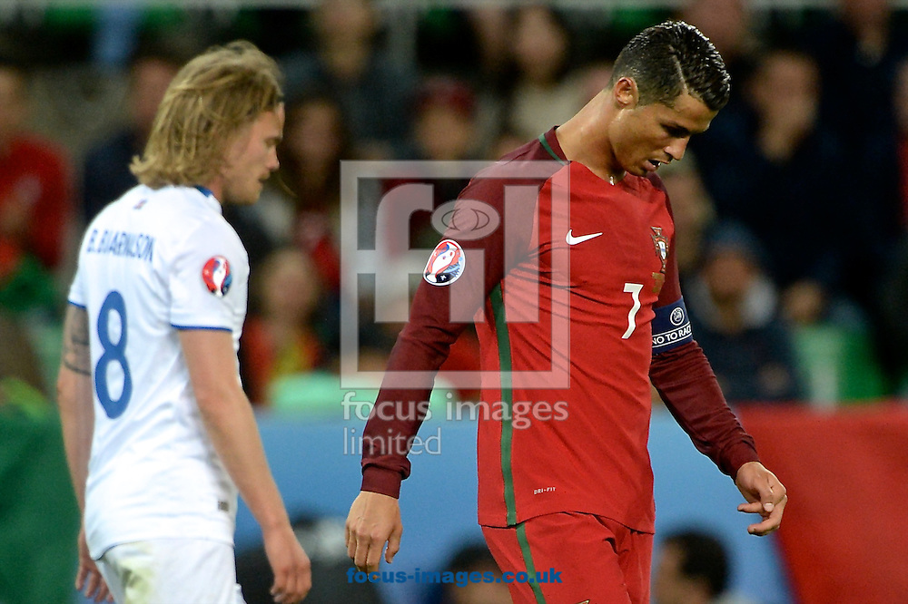Cristiano Ronaldo of Portugal (right) during the UEFA Euro 2016 match at Stade Geoffroy-Guichard, Saint-&Eacute;tienne, France<br /> Picture by Kristian Kane/Focus Images Ltd 07814482222<br /> 14/06/2016