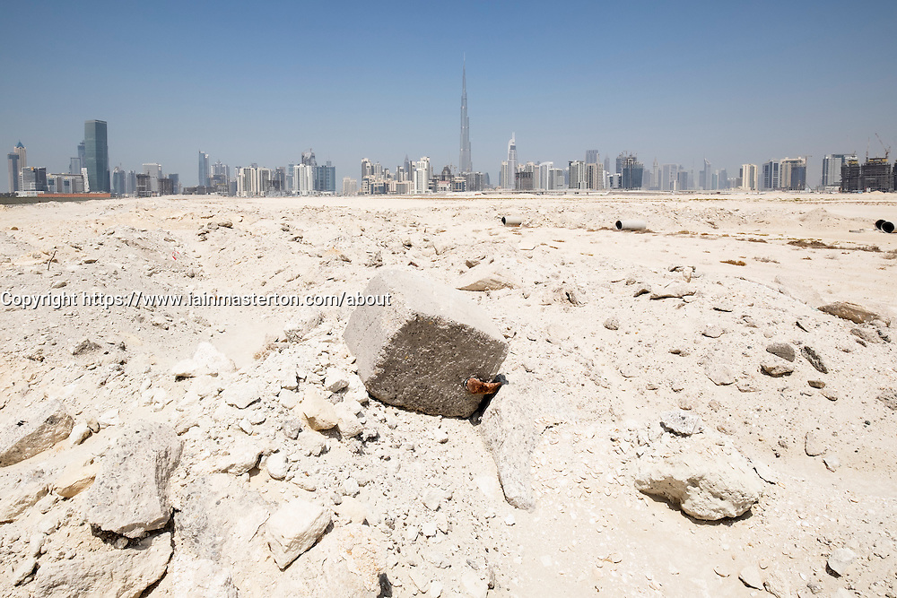 Skyline of skyscrapers from a construction site in the desert in Dubai United Arab Emirates