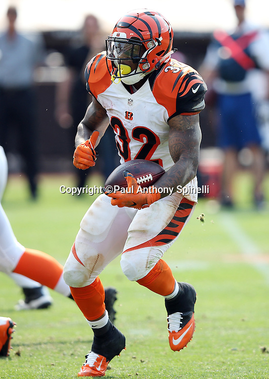 Cincinnati Bengals running back Jeremy Hill (32) makes a cut as he runs the ball during the 2015 NFL week 1 regular season football game against the Oakland Raiders on Sunday, Sept. 13, 2015 in Oakland, Calif. The Bengals won the game 33-13. (©Paul Anthony Spinelli)