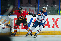 PENTICTON, CANADA - SEPTEMBER 8: Andrew Mangiapane #88 of Calgary Flames is checked by Caleb Jones #82 of Edmonton Oilers on September 8, 2017 at the South Okanagan Event Centre in Penticton, British Columbia, Canada.  (Photo by Marissa Baecker/Shoot the Breeze)  *** Local Caption ***