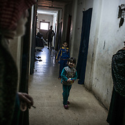 Mahmoud Abu Sbeih, 70, a palestinian refugee who escaped Syria with his family, walks in the corridors of the building of Cyber City, on december 20th 2013.