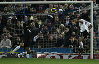 Photo: Lee Earle.<br /> Portsmouth v Tottenham Hotspur. The Barclays Premiership. 01/01/2007. Tottenham's Steed Malbranque (R) heads past David James for their equalising goal.