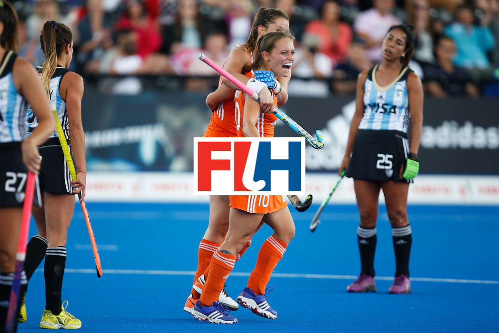 LONDON, ENGLAND - JUNE 25:  Kelly Jonker of the Netherlands is embraced by teammate Lidewij Welten after scoringa goal during the FIH Women's Hockey Champions Trophy 2016 match between Argentina and the Netherlands at Queen Elizabeth Olympic Park on June 25, 2016 in London, England.  (Photo by Joel Ford/Getty Images)