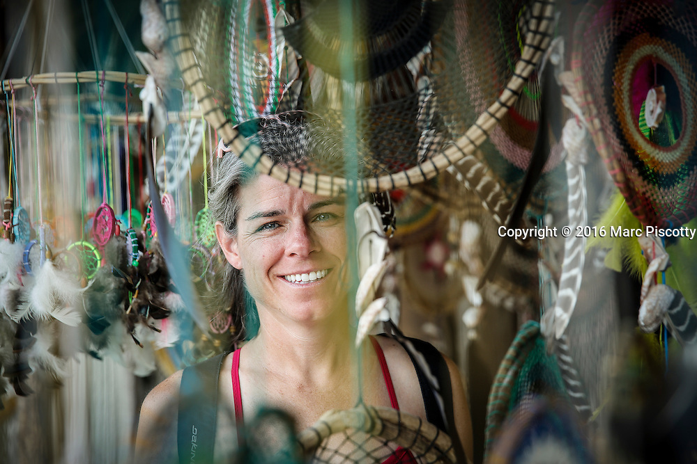 SHOT 12/9/16 1:55:34 PM - Missy Simpson of Denver, Co. looks at dream catchers at a small art market along the road in Macario Gomez just outside of Tulum, Mexico. Tulum is located in the Mayan Riviera and along the east coast of the Yucatán Peninsula on the Caribbean Sea in the state of Quintana Roo, Mexico. (Photo by Marc Piscotty / © 2016)