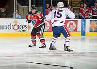 KELOWNA, CANADA - OCTOBER 10:  Carter Rigby #11 of the Kelowna Rockets gets in the face of Carter Proft #15 of the Spokane Chiefs at the Kelowna Rockets on October 10, 2012 at Prospera Place in Kelowna, British Columbia, Canada (Photo by Marissa Baecker/Shoot the Breeze) *** Local Caption ***