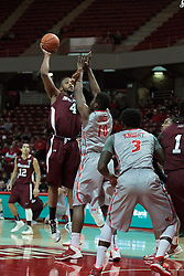 05 January 2014:  Davante Drinkard shoots over John Jones during an NCAA  mens basketball game between the Salukis of Southern Illinois and the Illinois State Redbirds  in Redbird Arena, Normal IL.  Final score ISU 66, SIU 48