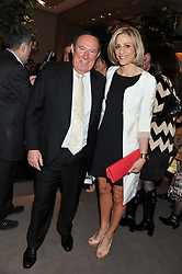 ANDREW NEIL and EMILY MAITLIS at the launch party for Spectator Life hosted by Andrew Neil at Asprey, 167 New Bond Street, London on 28th March 2012.