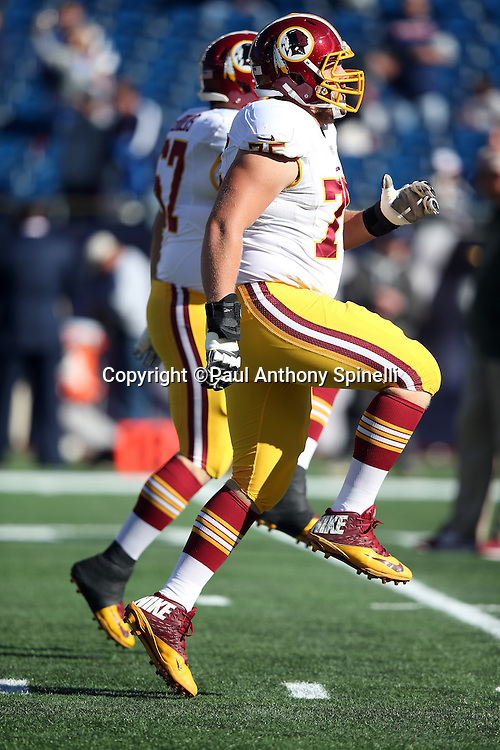 Washington Redskins offensive guard Brandon Scherff (75) and Washington Redskins center Josh LeRibeus (67) high step in unison while warming up before the 2015 week 9 regular season NFL football game against the New England Patriots on Sunday, Nov. 8, 2015 in Foxborough, Mass. The Patriots won the game 27-10. (©Paul Anthony Spinelli)