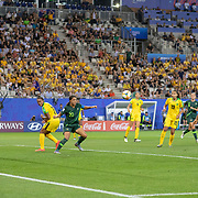 GRENOBLE, FRANCE June 18.  Sam Kerr #20 of Australia scores her third goal as she shoots past Sashana Campbell #12 of Jamaica, Allyson Swaby #17 of Jamaica and goalkeeper Nicole McClure #13 of Jamaica during the Jamaica V Australia, Group C match at the FIFA Women's World Cup at Stade des Alpes on June 18th 2019 in Grenoble, France. (Photo by Tim Clayton/Corbis via Getty Images)