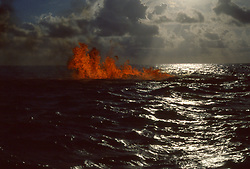 Stock Photo of gas well burning offshore in Gulf of Mexico