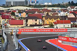 10.10.2014, Sochi Autodrom, Sotschi, RUS, FIA, Formel 1, Grosser Preis von Russland, Training, im Bild Kimi Raikkonen (FIN) Ferrari F14 T and Daniil Kvyat (RUS) Scuderia Toro Rosso STR9. // during the Practice of the FIA Formula 1 Russia Grand Prix at the Sochi Autodrom in Sotschi, Russia on 2014/10/10. EXPA Pictures © 2014, PhotoCredit: EXPA/ Sutton Images<br /> <br /> *****ATTENTION - for AUT, SLO, CRO, SRB, BIH, MAZ only*****
