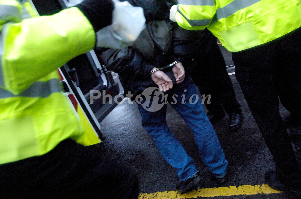 Arrest of suspect after early morning police drugs raid; part of ongoing Operation Crystal; Abbots Langley UK