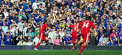 LIVERPOOL, ENGLAND - Saturday, October 1, 2011: Liverpool's Andy Carroll celebrates scoring the first goal against Everton during the Premiership match at Goodison Park. (Pic by David Rawcliffe/Propaganda)
