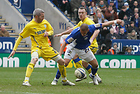 Photo: Steve Bond/Richard Lane Photography. Leicester City v Cardiff City. Coca Cola Championship. 13/03/2010. Kevin McNaughton (L) tangles with James Vaughan