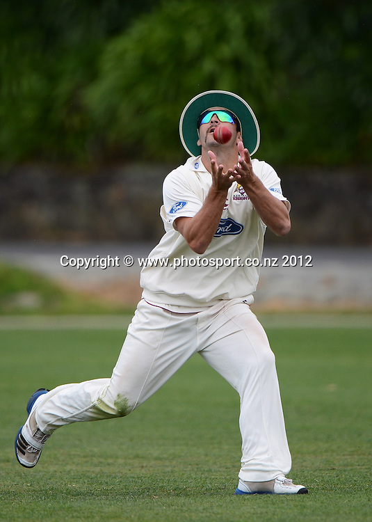 Anton Devcich takes a catch to dismiss Bruce Martin. Plunket Shield Cricket, Auckland Aces v Northern Knights at Eden Park Outer Oval. Monday 12 November 2012. Photo: Andrew Cornaga/Photosport.co.nz