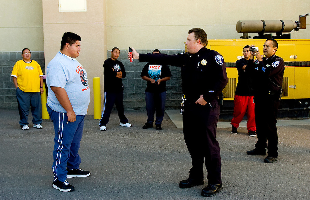 102208      Brian Leddy .Corrections Officer Lt. Shaun Ebright sprays trainee Isaac Martinez with mace during a training exercise at the McKinley County Adult Detention Center on Wednesday. The macing is the final step in the four week training program.