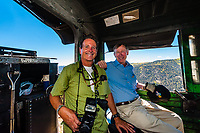 Photographer Blaine Harrington III and Governor John Hickenlooper of Colorado riding in the steam locomotive of the Cumbres & Toltec Scenic Railroad in southern Colorado.