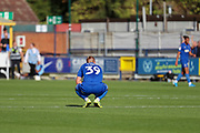 AFC Wimbledon striker Joe Pigott (39) kneeling down after Shrewsbury Town score goal during the EFL Sky Bet League 1 match between AFC Wimbledon and Shrewsbury Town at the Cherry Red Records Stadium, Kingston, England on 14 September 2019.