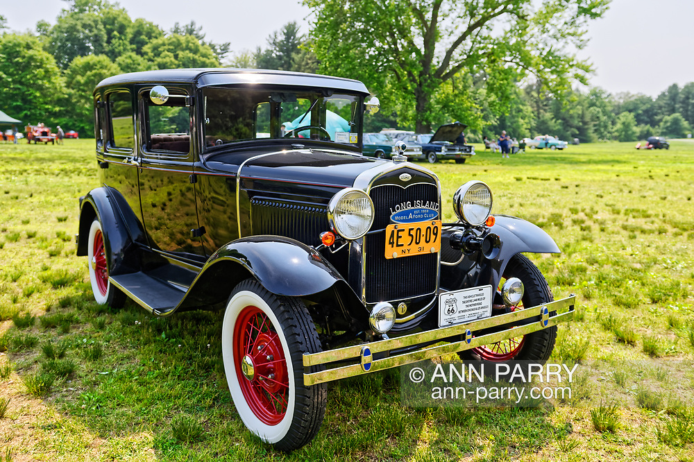Old Westbury, New York, USA. June 2, 2019. Owner Roger Clark's 1931 Ford Roadster won Second Place in Model A category at the 53rd Annual Spring Meet Antique Car Show, sponsored by the Greater NY Region (NYGR) of the Antique Car Club of America (AACA), at Old Westbury Gardens. The antique car had a blue grill emblem: Long Island Est. 1959,  Model A Ford Club, a Long Island Gold Coast estate. At front bumper, plaque states the vehicle traveled the entire 2,448 miles of the Mother Road between Chicago and Los Angeles.