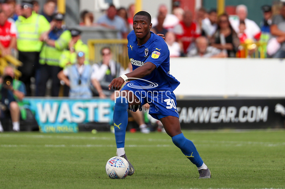 AFC Wimbledon defender Paul Kalambayi (30) dribbling during the EFL Sky Bet League 1 match between AFC Wimbledon and Rotherham United at the Cherry Red Records Stadium, Kingston, England on 3 August 2019.
