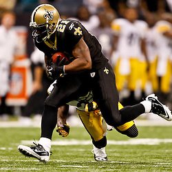 Oct 31, 2010; New Orleans, LA, USA; New Orleans Saints running back Julius Jones (21) runs away from Pittsburgh Steelers cornerback Bryant McFadden (20) during the second half at the Louisiana Superdome. The Saints defeated the Steelers 20-10.  Mandatory Credit: Derick E. Hingle