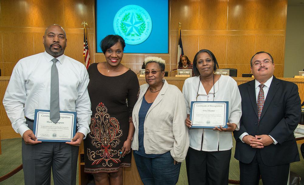 L_R: Mark Thompson, Wanda Adams, Wretha Thomas, Sibyl Hunter and Leo Bobadilla pose for a photograph during the Board of Education meeting, October 9, 2014.