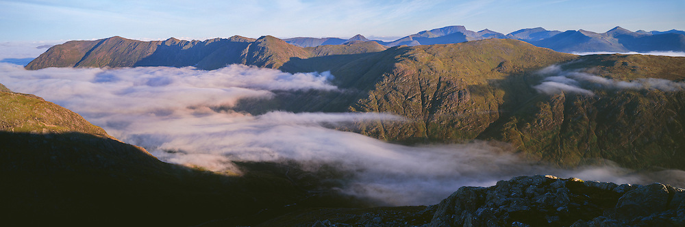 A temperature inversion takes hold in the Glencoe Valley from Buchaille Etive Beag.