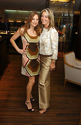 Left to right, EMILY OPPENHEIMER and BEATRICE WARRENDER at a party to celebrate the publication of 'The Russian House' by Ella Krasner held at De Beers, 50 Old Bond Street, London W1 on 9th June 2005.<br />