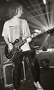 Andrew Innes of Primal Scream playing guitar at a show, UK, 1980s