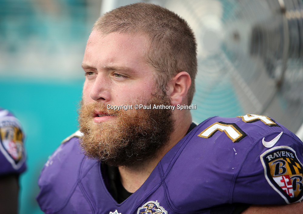 Baltimore Ravens tackle James Hurst (74) looks on from the sideline during the 2015 week 13 regular season NFL football game against the Miami Dolphins on Sunday, Dec. 6, 2015 in Miami Gardens, Fla. The Dolphins won the game 15-13. (©Paul Anthony Spinelli)