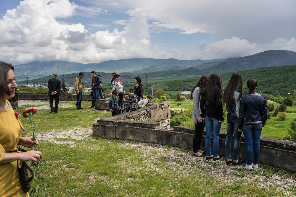 People gather to look out over the mountains following a ceremony commemorating both the victory over Nazi Germany in the Second World War as well as the fall of the strategic town of Shushi to Armenian forces on Monday, May 9, 2016 in Stepanakert, Nagorno-Karabakh.