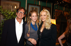 FRANCESCO & GAEL BOGLIONE with their daughter LARA BOGLIONE at a party to celebrate the publication on 'A Year in My Kitchen' by Skye Gyngell held at The Petersham Nurseries, Petesham, Surrey on 19th October 2006.<br />