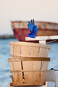 A blue fisherman's glove drying on a crab boat in Wancheese harbor.