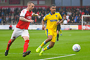 Kwesi Appiah of AFC Wimbledon (9) chases Peter Clarke of Fleetwood Town (4) during the EFL Sky Bet League 1 match between Fleetwood Town and AFC Wimbledon at the Highbury Stadium, Fleetwood, England on 10 August 2019.