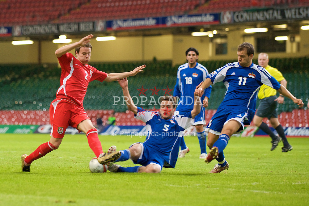 CARDIFF, WALES - Saturday, October 11, 2008: Wales' Chris Gunter is fouled by Liechtenstein's Andreas Gerster during the 2010 FIFA World Cup South Africa Qualifying Group 4 match at the Millennium Stadium. (Photo by David Rawcliffe/Propaganda)