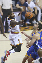 The Cleveland Cavaliers' Kyrie Irving passes inside during the first quarter as  the Golden State Warriors' Zaza Pachulia defends during Game 4 of the NBA Finals at Quicken Loans Arena in Cleveland on Friday, June 9, 2017. (Photo by Phil Masturzo/Akron Beacon Journal/TNS) *** Please Use Credit from Credit Field ***