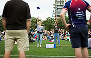 Festival-goers play a game of cornhole during the 4th annual Yum Yum Fest held at Breese Stevens Field in Madison, Sunday, August 6, 2017.