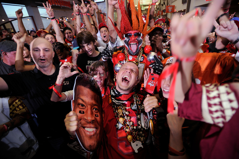 Tampa Bay Buccaneer fans celebrate the team's pick of Jameis Winston during a draft day party held at Raymond James Stadium Thursday, April 30, 2015 in Tampa.