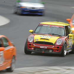 May 23, 2009; Lakeville, CT, USA; The RSR Motorsport Mini Cooper S of Adam Burrows and Trevor Hopwood races in the Grand-Am Koni Sports Car Challenge series competition during the Memorial Day Road Racing Classic weekend at Lime Rock Park.