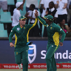AB de Villiers (capt) of the (South African Proteas) with Andile Phehlukwayo of the (South African Proteas) during the 2nd ODI Momentum One-Day International (ODI) series South African and Sri Lanka at Kingsmead, Durban, South Africa.1st February 2017 - (Photo by Steve Haag)