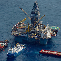 Transocean's Development Driller II leased by BP Plc works to drill a second relief well at the source of the BP Plc Deep Water Horizon oil spill site in the Gulf of Mexico off the coast of Louisiana, U.S., on Sunday, July 11, 2010. Oil is once again gushing freely into the Gulf of Mexico as BP Plc is in the process of changing out the cap from the leaking well and plans to have a new cap installed over the next few days that will allow for oil to be captured efficiently. Photographer: Derick E. Hingle/Bloomberg