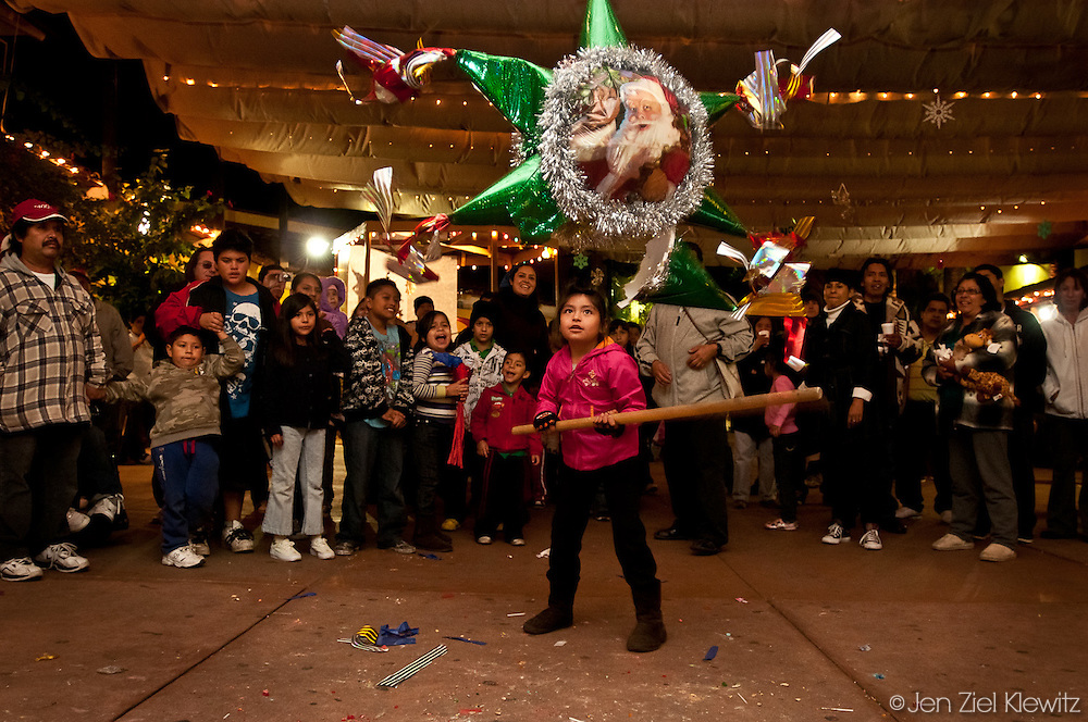 Children take turns taking a swing at a piñata at a Christmas-related event  at Our Lady Queen of Angels Church,  Los Angeles, Calif., on December 29, 2009. Photo by Jen Klewitz