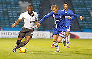 Bury FC Defender Nathan Cameron holds off Gillingham FC midfielder Josh Wright with a bit of shirt tugging during the Sky Bet League 1 match between Gillingham and Bury at the MEMS Priestfield Stadium, Gillingham, England on 14 November 2015. Photo by Andy Walter.