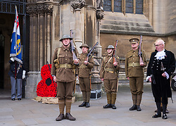 "© Licensed to London News Pictures. 27/10/2018. Bristol, UK. The Royal British Legion launch this year's Bristol Poppy Appeal, ""One thousand poppies, for one hundred years, for one million lives"" at Bristol Cathedral. For the launch of the 2018 Bristol Poppy Appeal at 11am on 27 October, the Royal British Legion recreated a scene from the end of WW1 outside Bristol Cathedral on College Green, and Colonel Clive Fletcher-Wood read the war poem In Flanders Fields. They were joined by Civic Dignitaries Peaches Golding the Lord Lieutenant of Bristol, City of Bristol High Sheriff Mr Roger Opie (pictured), and Bristol's Lord Mayor Cleo Lake. A Bugler and the Bristol Military Wives Choir performed songs from their new album 'Remember'. Staff at MOD Filton filled 400 sandbags with eight tonnes of sand to build trenches and recreate 'Flanders Fields' and planted over 1000 waterproof poppies on College Green. Poppies and sandbags can be sponsored by individuals wanting to remember those who fought and died in conflict. There were re-enactors in WW1 uniform from Somerset Light Infantry (known as the West Country Tommys), as well as medics and nurses with equipment from the time. Bristol's own 'War Horse' (Buzz from Blagdon Horsedrawn Carriages) was on College Green behind the improvised barbed wire to represent the 350,000 horses that left Avonmouth for the frontline during WW1. There are also 10,000 knitted poppies on display both in and outside Bristol Cathedral following 'The Charfield Yarn Bombers' incitement to locals to get knitting to mark the occasion, with a display inside the Cathedral organised by Helen Date. Photo credit: Simon Chapman/LNP"