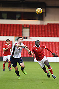 Bolton's U23 Liam Edwards and Nottingham Forest U23's Virgil Gomis concentrating on the ball during the U23 Professional Development League Play-Off Final match between Nottingham Forest and Bolton Wanderers at the City Ground, Nottingham, England on 4 May 2018. Picture by Jon Hobley.