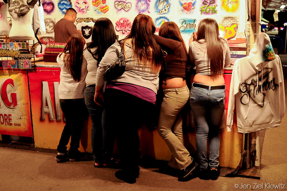 Girls from Indio, California, decide on a which airbrush design to get drawn on a tee-shirt at a vendor's  booth at the Riverside County Fair and National Date Festival, in Indio, California on February 13, 2009. Photo by Jen Klewitz