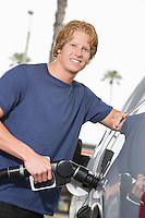 Portrait of young man with fuel pump