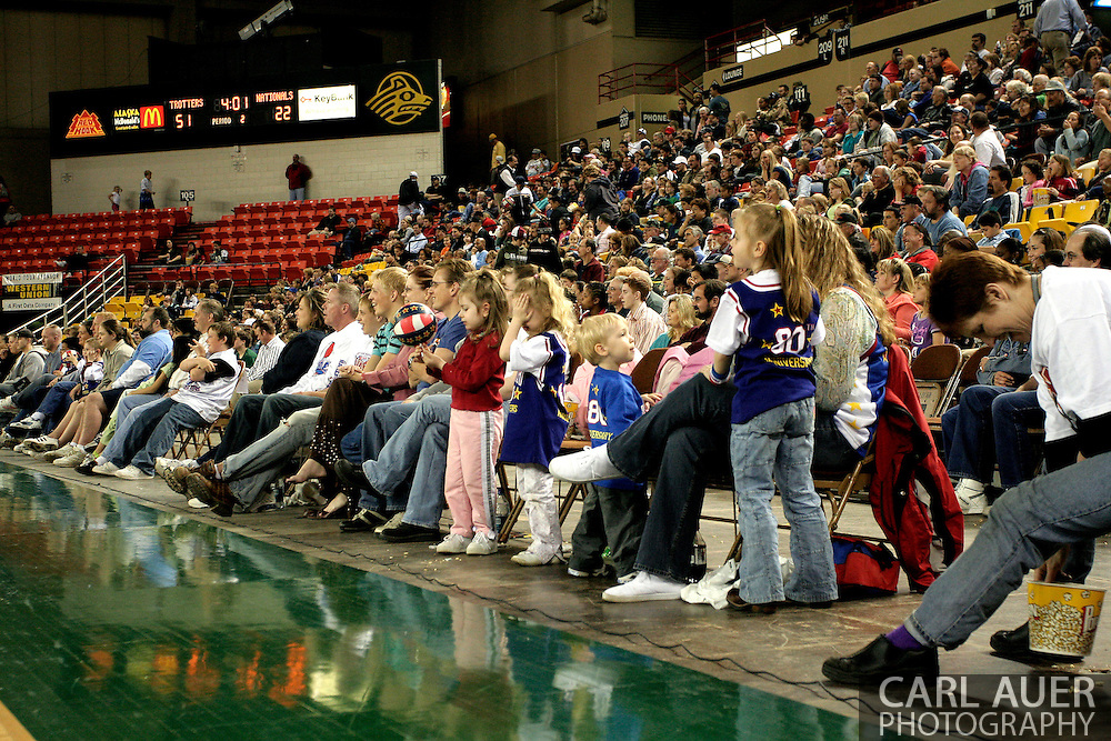 04 May 2006: Alaska fans are glued to the comedic action of 'Special K' during the Harlem Globetrotters vs the New York Nationals at the Sulivan Arena in Anchorage Alaska during their 80th Anniversary World Tour.  This is the first time in 10 years that the Trotters have visited Alaska.